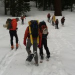 Setting off to find a good hill for our snow anchors training.